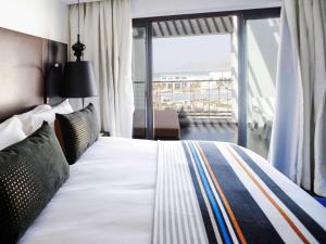 Un ou plusieurs lits dans un hébergement de l'établissement Hotel Sofitel Agadir Thalassa Sea & Spa