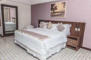 A bed or beds in a room at Hotel Ferradura Private