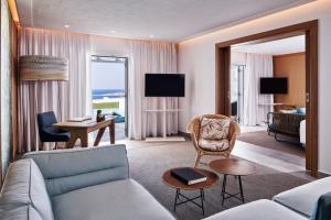 A seating area at Myconian Kyma - Design Hotels