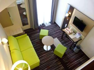 A seating area at Mercure Granville Le Grand Large