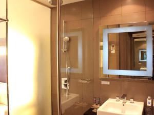 A bathroom at Novotel Bangka Hotel & Convention Center