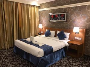 Cama ou camas em um quarto em Wahat Al Nafil