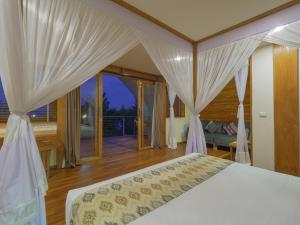 A bed or beds in a room at Komodo Resort