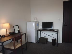 A television and/or entertainment center at Pensione UNO