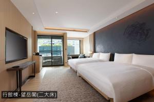 礁溪寒沐酒店房間的床