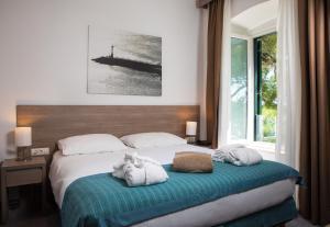 Un ou plusieurs lits dans un hébergement de l'établissement Hotel Mlini