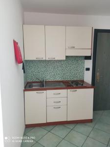 A kitchen or kitchenette at La Residenza Aparthotel