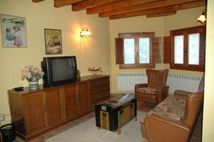 A television and/or entertainment center at Casa Rural El Colorao