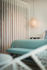 Een bed of bedden in een kamer bij Blaumar Hotel