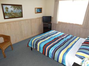 A bed or beds in a room at Ripples n Tonic Farmstay