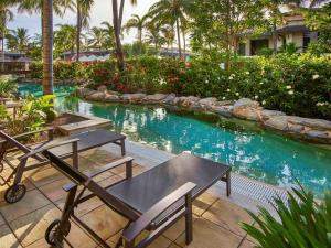 The swimming pool at or near Pullman Port Douglas Sea Temple Resort and Spa