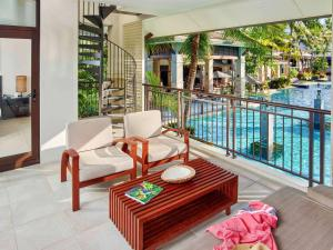 A view of the pool at Pullman Port Douglas Sea Temple Resort and Spa or nearby