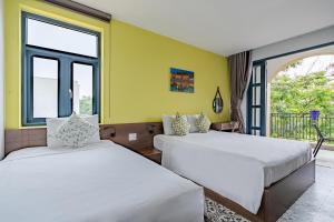 A bed or beds in a room at Lami Villa Hoian 1