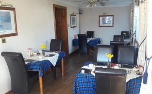 A restaurant or other place to eat at Lyndon Guest House