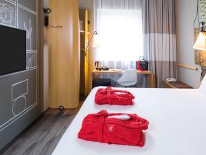Un ou plusieurs lits dans un hébergement de l'établissement ibis De Haan