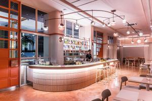 A restaurant or other place to eat at Craftsman Bangkok