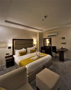 Cama ou camas em um quarto em فندق برج الإبريز