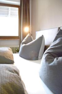 Ein Bett oder Betten in einem Zimmer der Unterkunft Almhof Baumgarten