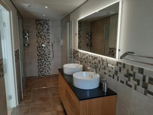 Een badkamer bij Hotel De Dennen