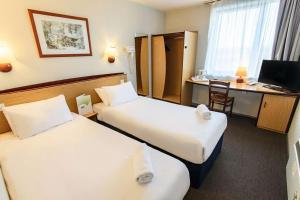A bed or beds in a room at Campanile Liverpool