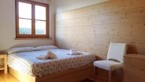 Cama o camas de una habitación en Appartamenti Passo Giau