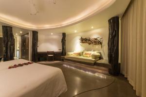 A bed or beds in a room at Nayara Hangaroa