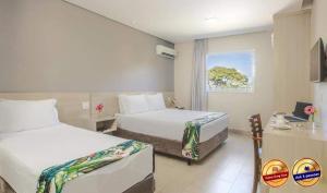Кровать или кровати в номере Valinhos Plaza Hotel