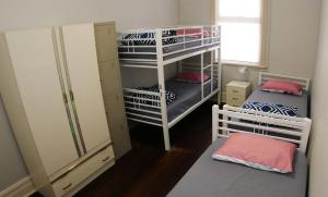A bunk bed or bunk beds in a room at Geraldton Backpackers