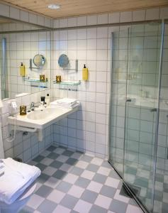 A bathroom at Voksenasen Hotell; Best Western Signature Collection