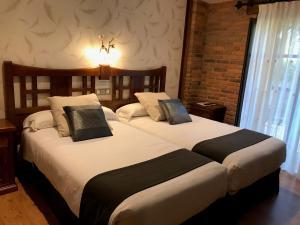 Cama o camas de una habitación en Hotel Spa San Marcos