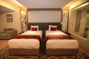 A bed or beds in a room at Radisson Udaipur