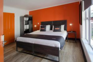 A bed or beds in a room at never@home Cape Town