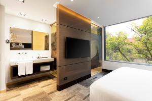 A television and/or entertainment center at EK Hotel