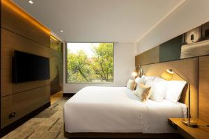 A bed or beds in a room at EK Hotel