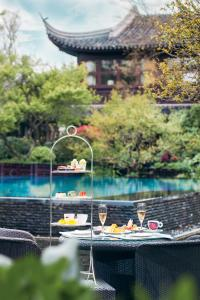 The swimming pool at or near Four Seasons Hotel Hangzhou at West Lake