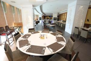 A restaurant or other place to eat at Radisson Udaipur