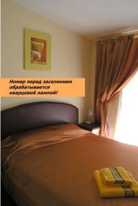 A bed or beds in a room at Art Villa on Sumskaya Street