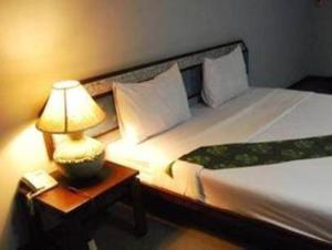 A bed or beds in a room at King Royal Garden Inn