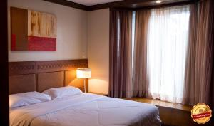 A bed or beds in a room at Laje de Pedra Mountain VillagePrime