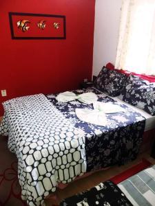 Cama ou camas em um quarto em Pousada TonaPraia