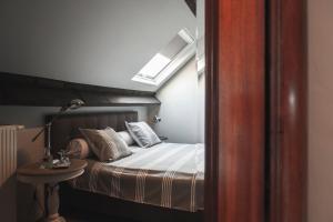 Ein Bett oder Betten in einem Zimmer der Unterkunft B&B La Passion Interdite