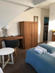 Un ou plusieurs lits dans un hébergement de l'établissement Badhotel Renesse
