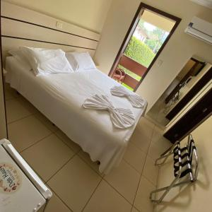 A bed or beds in a room at Dein Haus Pousada