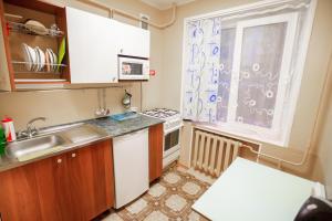 Кухня или мини-кухня в Гостиница квартирного типа Ленина 40