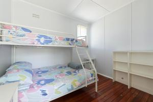 A bunk bed or bunk beds in a room at Calm Waters Waterfront Cottages