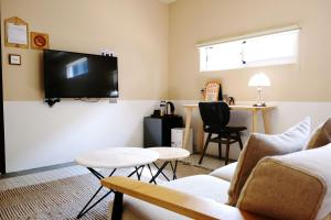 A television and/or entertainment center at Chill Roof Hotel