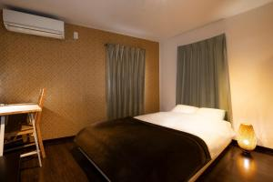 A bed or beds in a room at Apartment Sun Bright Shinagawa