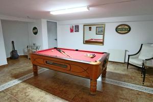 A pool table at Villa Paradise