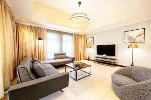 A seating area at Dubai Creek Club Villas