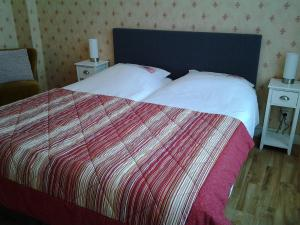A bed or beds in a room at Bed & Breakfast Meinsma
